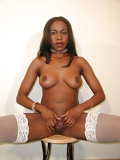 Lewd Black Stripping Down To Her White Nylons